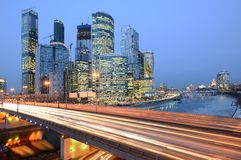 Evening view of the road and business city center. Royalty Free Stock Image