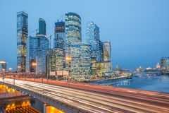 Evening view of the road and business city center. Royalty Free Stock Photography