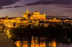 Evening view from Roman bridge at the Mosque-Cathedral in Cordoba, Spain. Evening view from Roman bridge at the Mosque-Cathedral in Cordoba - Spain Stock Photo