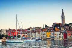 Evening view on sailboat harbor in Rovinj with many moored sail boats and yachts, Croatia Stock Images
