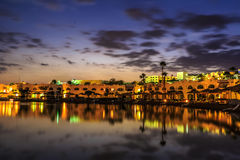 Evening view from sea for luxury hotel in night illumination Royalty Free Stock Images