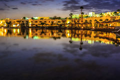 Evening view from sea for luxury hotel in night illumination Royalty Free Stock Photography