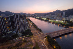 Evening view of Shatin River with residential building in Hong Kong Stock Photo