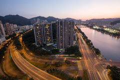 Evening view of Shatin River with residential building in Hong Kong Royalty Free Stock Image