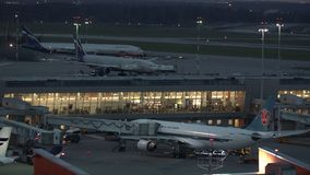 Evening view of Sheremetyevo Airport with Aeroflot and China Southern planes