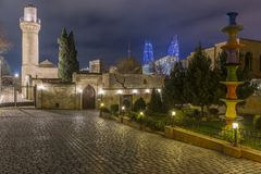 Evening view of the Shirvanshahs palace and Flame towers in the old town. stock photo