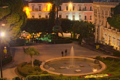 Evening view of a small park in the center of the city. Catania. Sicily. Italy royalty free stock images