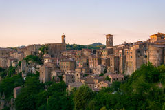 Evening view of Sorano, Tuscany, Italy. Evening view of the medieval town Sorano, Tuscany, Italy Stock Photography