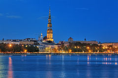 Evening view of the St. Peter's Church from the shore of Daugava in Riga Stock Photo