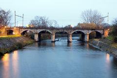 Evening view of a stony railway bridge Royalty Free Stock Photo
