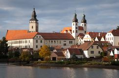 Evening view of Telc or Teltsch town mirroring in lake Stock Images
