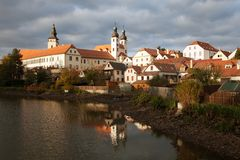 Evening view of Telc or Teltsch town mirroring in lake Royalty Free Stock Image