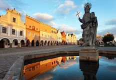 Evening view of Telc or Teltsch town square. Building mirroring in public fountain with statue of st. Margaret, Czech republic. World heritage site by unesco Stock Images