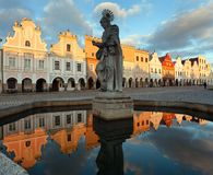 Evening view of Telc or Teltsch town square. Building mirroring in public fountain with statue of st. Margaret, Czech republic. World heritage site by unesco Stock Photography