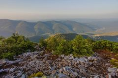 View from the top of the mountain on the bench royalty free stock image