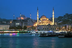 Evening view of Yeni Mosque and Eminonu pier in Istanbul, Turkey Royalty Free Stock Image