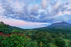 Powerful sky clouds & dramatic sky over the Arenal volcano at La Fortuna in Costa Rica royalty free stock image