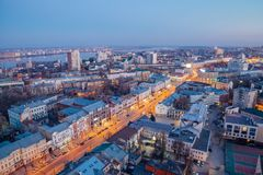 Evening Voronezh downtown. Aerial view from skyscraper roof height to Revolution prospect - central street of Voronezh.  Stock Photo