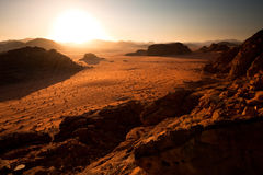 Evening at Wadi Rum. Sun is shining above the hills and mountains of Wadi Rum desert, Jordan stock image