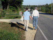 Evening Walk Together. Sr. Citizens Take Evening Walk Together royalty free stock photos