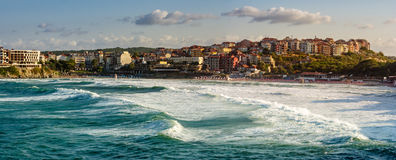 Evening waves near the shore of resort town. Evening waves before storm near the shore of ancient european resort town Sozopol in summer Stock Images