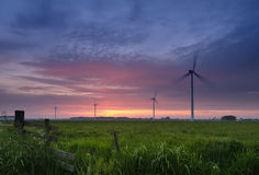 Evening at the windmills. Evening falls but the windmills keep working Royalty Free Stock Photography