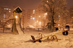 Evening winter city. The winter evening landscape with falling snow - soft focus processing Stock Image