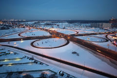 Evening winter cityscape with big interchange Royalty Free Stock Photo