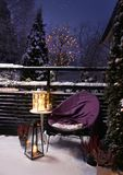 Winter garden evening Christmas feeling. Evening in winter garden warm Christmas feeling royalty free stock photo
