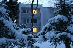 Evening winter house Stock Photos