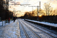 Evening winter landscape with the railway station Stock Photo