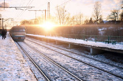 Evening winter landscape with the railway station Stock Photography