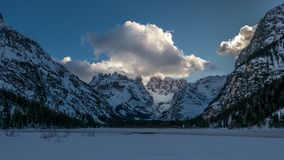 Evening in the winter mountain valley. Alpie slope illuminated by reflected sunlight Stock Photo