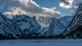 Evening in the winter mountain valley, illuminated alpine slope. Evening in the winter mountain valley, alpine slope illuminated by reflected sunlight Royalty Free Stock Photos
