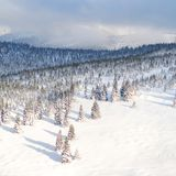 Evening winter snowy mountains landscape background. Winter holiday concept. Evening winter snowy mountains landscape background. Winter holiday concept Stock Images