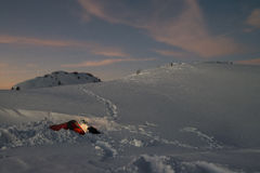 Winter camping in mountains. Evening winter time while camping in mountains royalty free stock photo