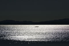 Eveningmood at Chiemsee. With small boat Royalty Free Stock Photo