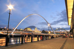Evenings Lights. The Quayside of Newcastle upon Tyne. The bridge is the Gateshead Millennium Bridge, and the curved building left of centre is the Sage Music Royalty Free Stock Photography