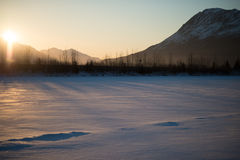 Eveningtime en los llanos nevados Foto de archivo libre de regalías