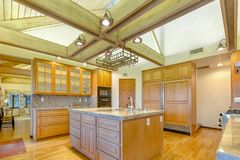 Evenly lit, open and warm kitchen with vaulted ceilings. Wonderful California home in San Diego county. Real estate listings with powerful visuals Stock Photos