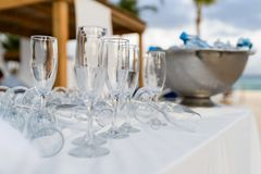 Empty glasses before reception with cooler in the background stock photos