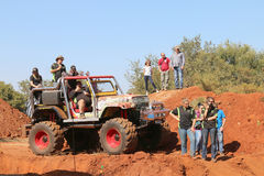 Event commentator on big foot large 4x4 with spectators looking. Rustenburg, South Africa – JUNE 17, 2017: National Extreme Modified 4x4 Vehicle Championship Royalty Free Stock Photography