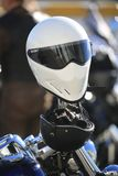 Two motorcycle helmets on a motorcycle handlebar close-up stock images