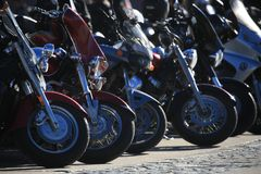 View of parked motorcycles from the shady side stock images