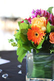 Event Flowers. A beautiful arrangement of flowers on table at reception Stock Photography