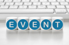 Event. Letter dice in front of a keyboard - Event royalty free stock photo