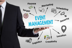 Event management concept with young man holding a tablet computer Stock Image
