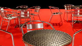 Event place, empty tables and chairs, red floor stock video footage