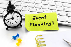 Event planning with clock. Event planning word on notepad with clock on white computer desk stock images