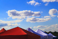 Red White Event Tents. Red and white wedding, Party or event tents on blue sky Stock Photos